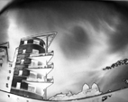 Pinhole, solarized of a building along the green flow